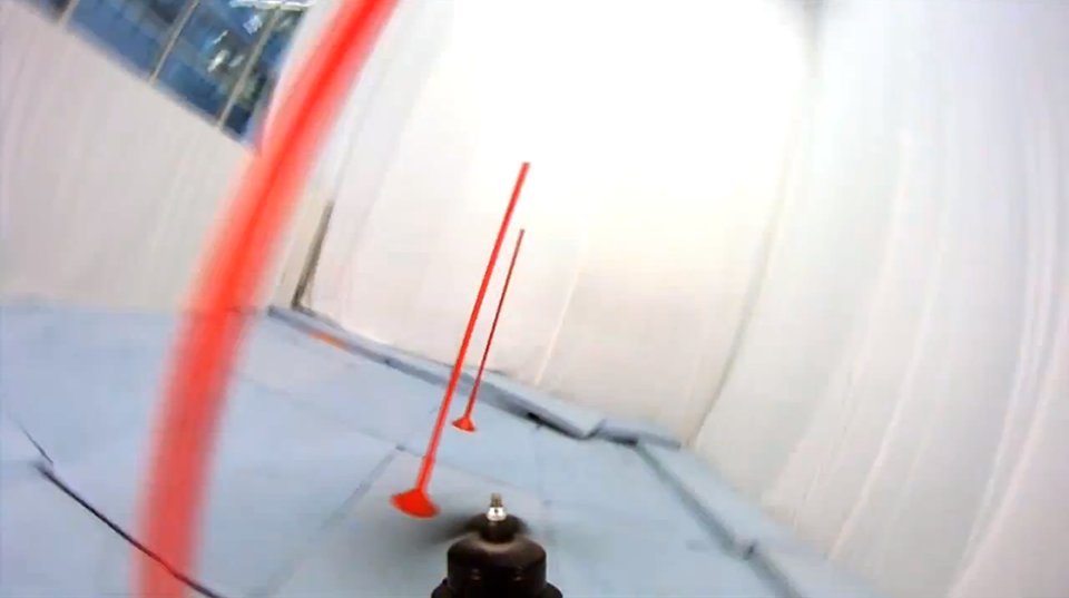 First person view of the quadrocopter racing through a pylon slalom course.
