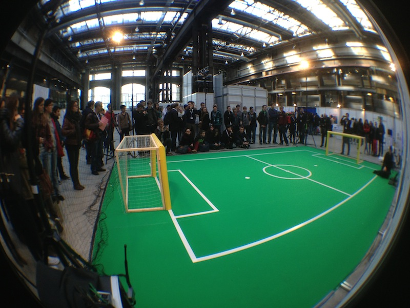 Students waiting for flying and soccer-playing robots