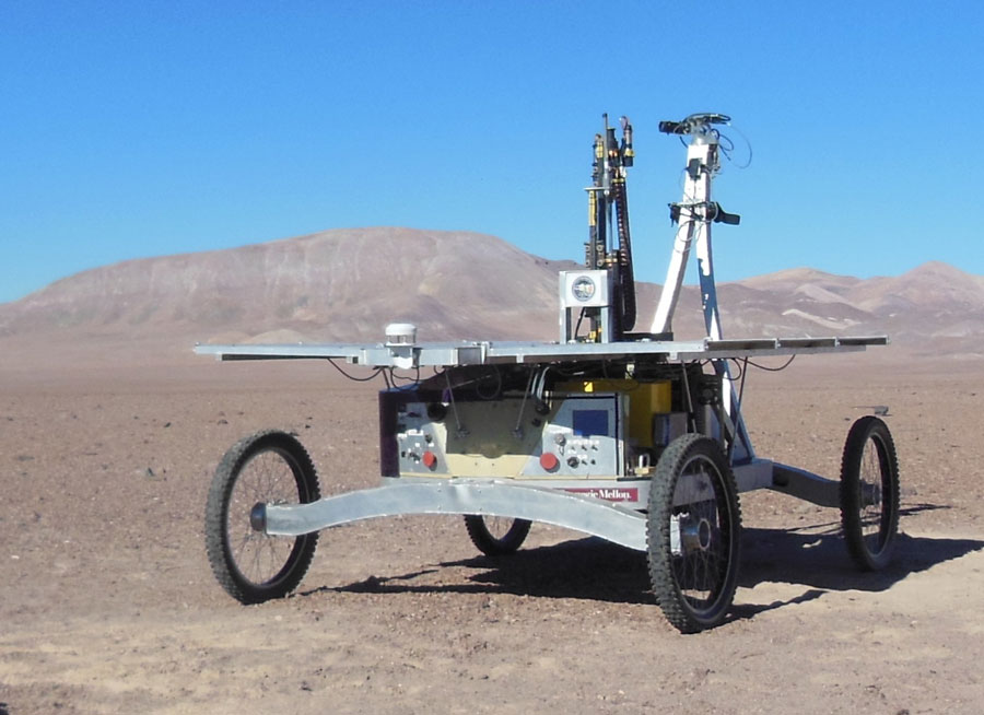 The 1-meter class Mars drill, LITA, during field testing on Carnegie Mellon's Zoe rover.