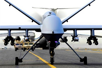Armed with Hellfire missiles, General Atomics Predator drone prepares for take-off.