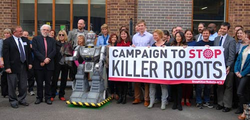 University of Sheffield (UK) AI and Robotics Professor Noel Sharkey (red tie) leading a group to protest killer robots.