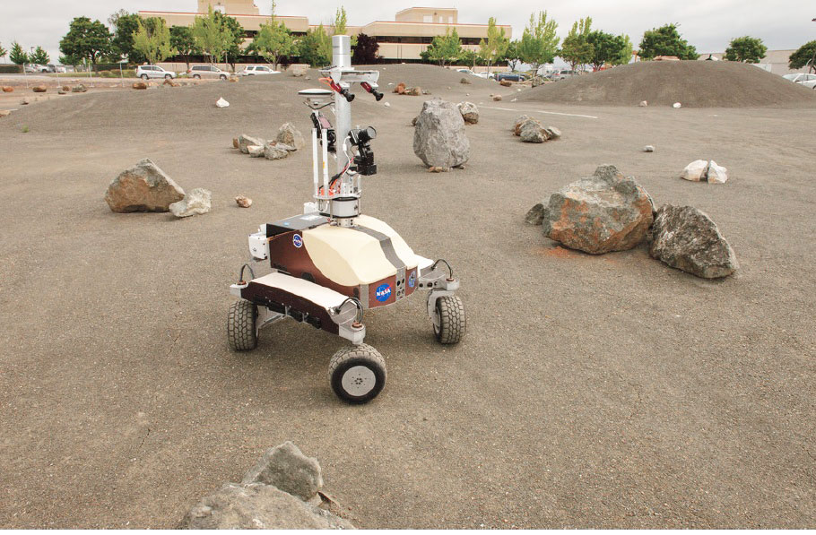 Photo credit: Dominick Hart/NASA. NASA's K10 rover at the Ames Research Center in Moffett Field, California performs a surface survey with its cameras and laser system, and then deployed a simulated polymide antenna while being controlled by an astronaut in space during a June 2013 test.