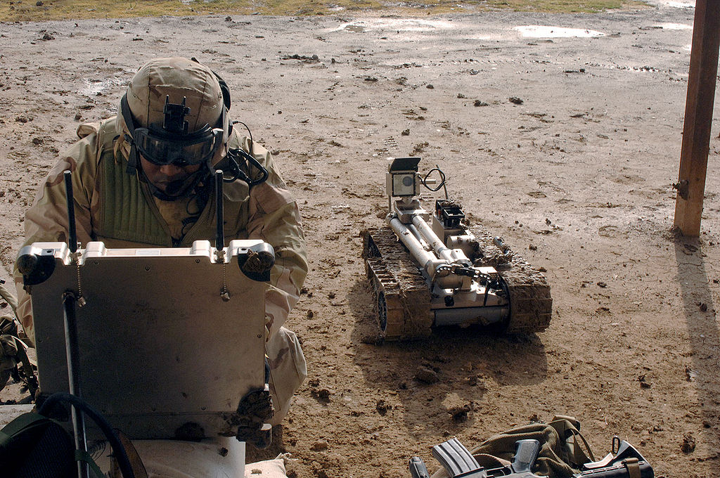 1024px-Military_robot_being_prepared_to_inspect_a_bomb