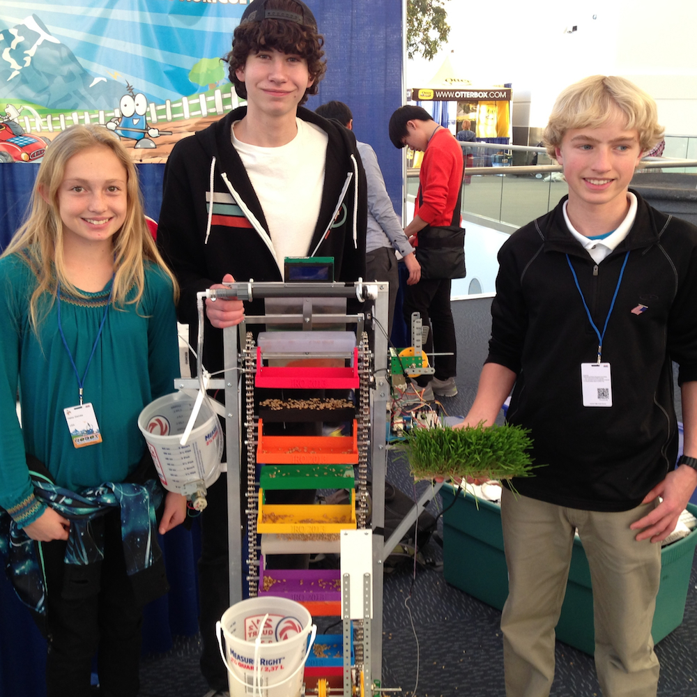 Haley Steinke, Ryan Ham, and Samuel Zimmer, of the Denver area, with their seed sprouting robot.