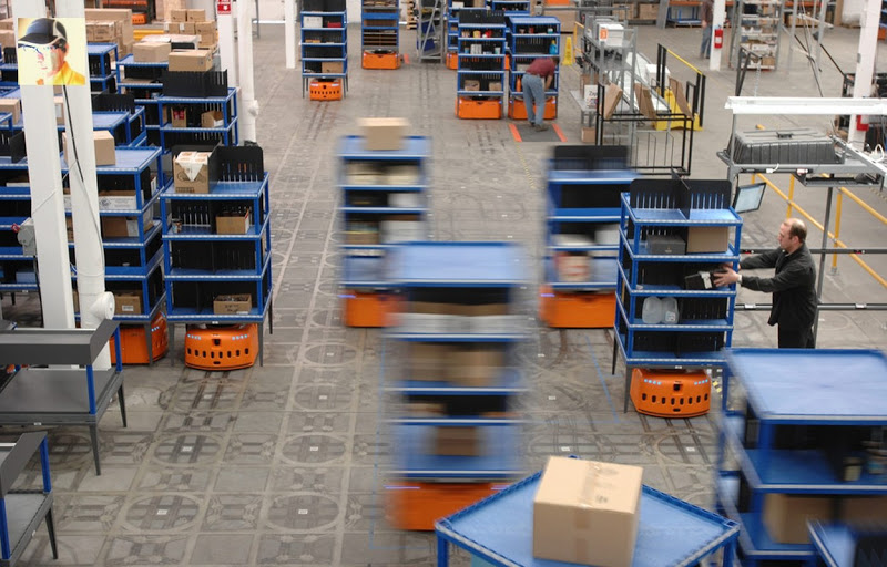 While Amazon doubles its number of warehouse robots to 30K