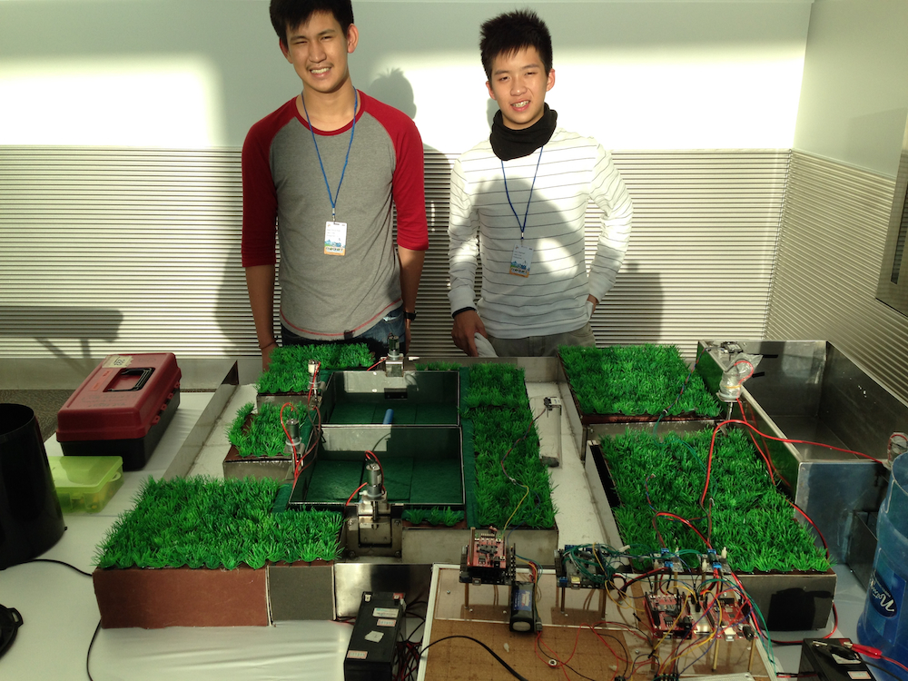 Sean Vince Ruel and John Raphael, of the Philippines, with their automatic rice paddy irrigation system.