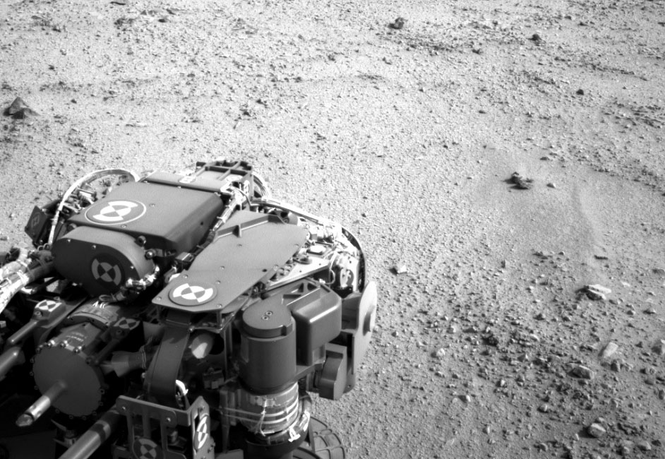 Curiosity Heading for Mount Sharp, during the 329th Martian day, or sol, of the rover's work on Mars (July 9, 2013).  The turret of tools at the end of Curiosity's robotic arm is in the foreground, with the rover's rock-sampling drill in the lower left corner of the image. Image credit: NASA/JPL-Caltech.