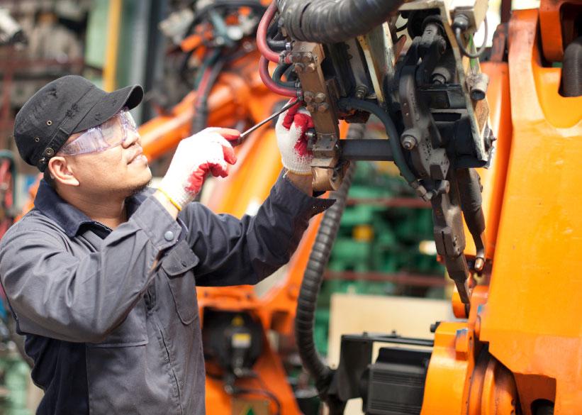 technician_repairing_industrial_robot
