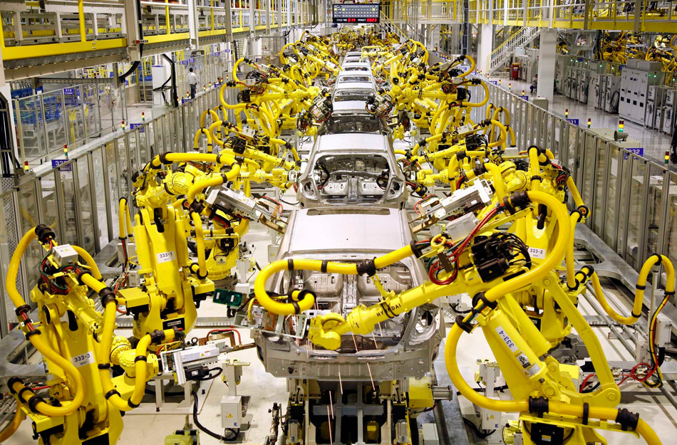 A factory robot is constructing cars