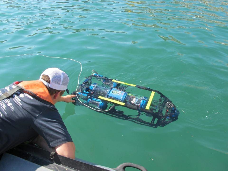 Team participating in SAUC-E sea robotics competition collects their robot from the sea. Photo credits: SAUC-E