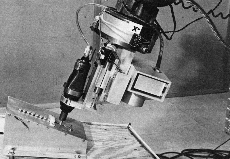 This image of a robot arm, developed by the Stanford Research Institute, is similar to the one that appeared in the 1976 NSF Annual Report. The robotic system used computer vision to identify and make decisions about parts on an assembly line. This is one of several projects from that era aimed at improving the productivity of American manufacturing processes. Credit: SRI International