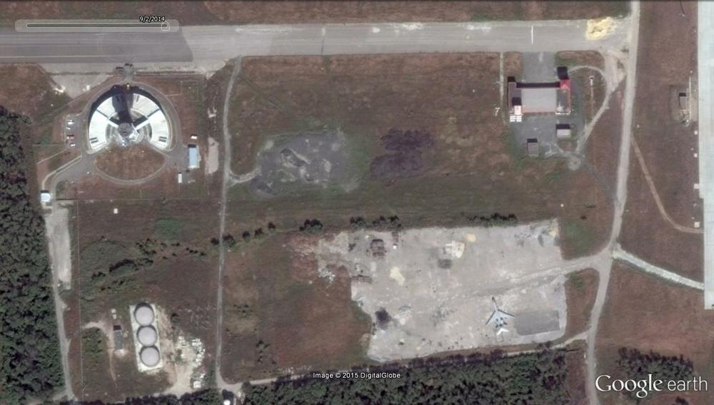 This satellite photo of the southwestern corner of the airport, also dated Sept. 2, 2014, shows some damage already had occurred to the air traffic control tower. The plane in the lower right of the image, most likely a Tupolev TU-134 transport, is intact but had been left in the same spot for months. It would be another three days before the cease-fire was signed.