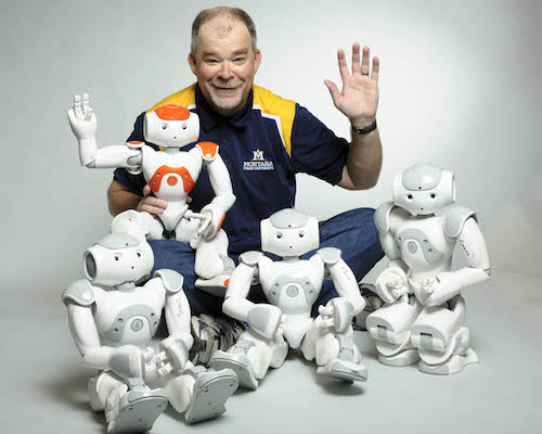 Hunter Lloyd with his Nao robots