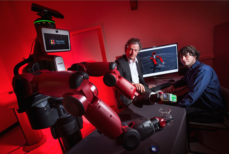 University of Maryland computer scientist Yiannis Aloimonos (center) is developing robotic systems able to visually recognize objects and generate new behavior based on those observations. Photo credit: John T. Consoli