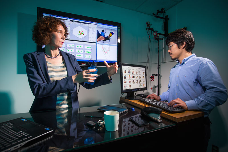 University of Maryland researcher Cornelia Fermuller (left) works with graduate student Yezhou Yang (right) on computer vision systems able to accurately identify and replicate intricate hand movements. Photo credit: John T. Consoli