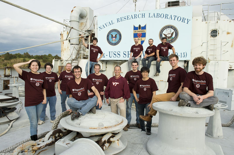 Firefighting robot: The SAFFiR team is pictured aboard the USS Shadwell. Front row, from left: Chris Nogales, John Peterson, Jason Ziglar, Jack Newton, Joseph Starr, Associate Professor Brian Lattimer, Joshua McNeil, Yoonchang Sung, Mike Rouleau, and James Burton. Back row, from left: Robert Griffin, Mike Hopkins, Viktor Orekhov, and John Seminatore. Coleman Knabe is not pictured. Source: Virginia Tech.