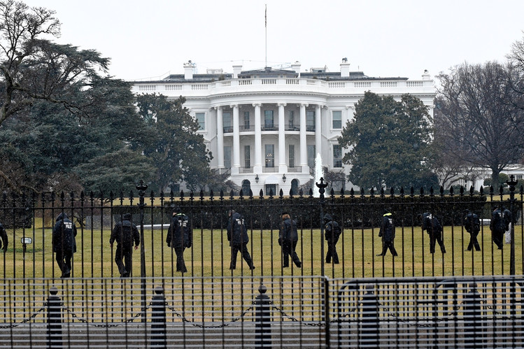 Secret Service officers search White House grounds after a hobbyist drone crashed on the lawn. Credit: Associated Press