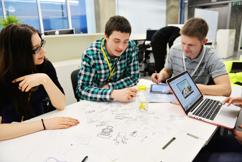 Students brainstorming for the design hackathon at the 2015 Skolkovo International Robotics Conference.  Photo credit: Skolkovo.