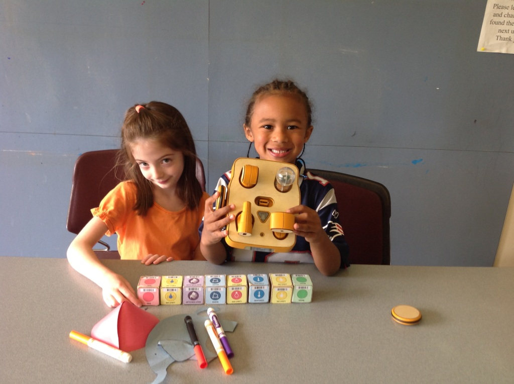 Kibo allows young tinkerers to build a robot using supplied modular components, personalize it with art designs and then program it to do their bidding using colored program blocks. Credit: DevTech research grouo, Tufts University