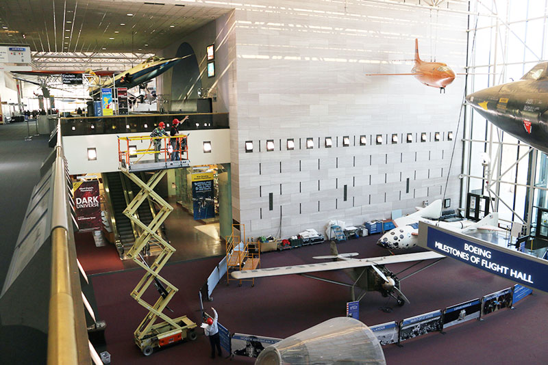 Museum staff hang the invisible plane and transform it into its jet formation. Photo courtesy: Marty Kelsey