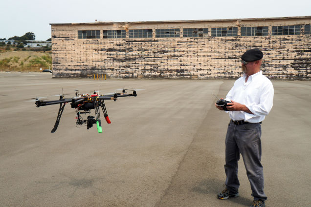 Mythbusters co-host Jaime Hyneman test flies a drone. Credit: DLC. Via: io9