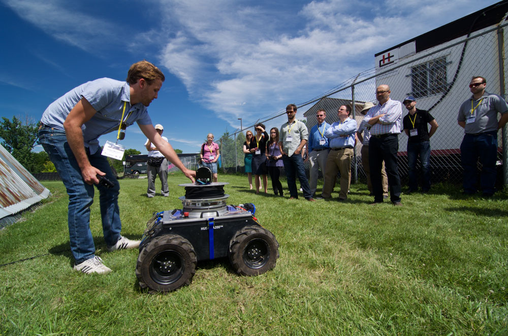 June 26, 2015 - The Tethered Robotic Explorer (TReX) robot being described by Patrick McGarey to a visiting group. The newly conceived platform was unveil to the public for the first time. TReX can climb many kind of steep terrain with the help of its onboard tether management system. It weighs roughly 90 kg and was built over a Husky from Clearpath Robotics. Photo credit: François Pomerleau - University of Toronto