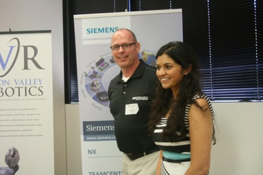 Rich Mahoney, Director of Robotics SRI International (and Robot Launch judge) presenting award to runner up, Pree Wallia, CEO & Founder of Preemadonna, inventors of the NailBot.