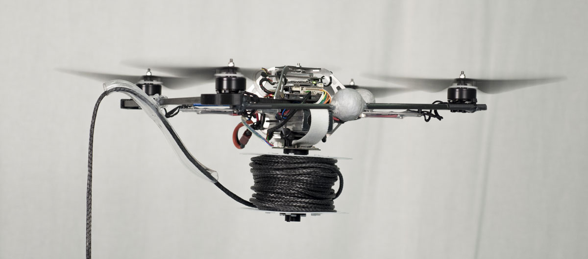 A quadrocopter equipped with a motorized spool for rope deployment.