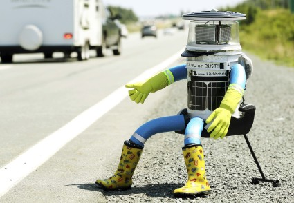 The anthropomorphic robot named hitchBOT sits on the shoulder of Highway 102 to begin its 6000 kilometer cross country journey outside of Halifax, Nova Scotia, July 27, 2014. The hitch hiking robot is part of a social experiment to see if drivers will pick up and drop off the robot in one piece to an art gallery in Victoria, British Columbia.  REUTERS/Paul Darrow (CANADA - Tags: SOCIETY SCIENCE TECHNOLOGY TPX IMAGES OF THE DAY)