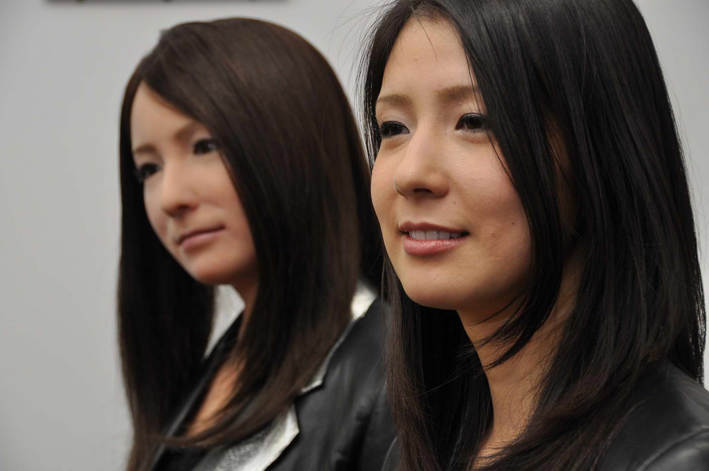 Woman with look-alike robot.