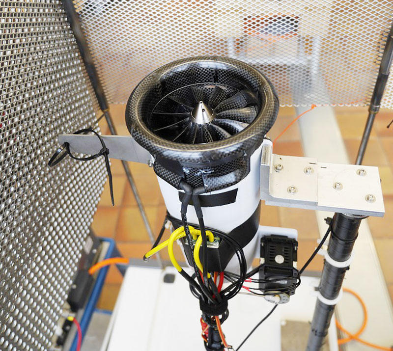 Figure 1: The test bench for characterizing the electric ducted fan and the thrust vectoring system.