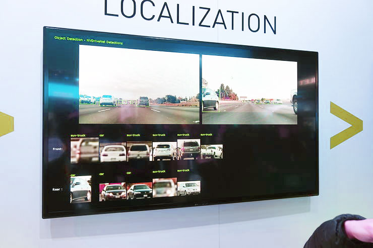 NVIDIA's software suite was shown off.  Here we see not the localization but the their computer vision system tagging cars and trying to identify them. Photo credit: Brad Templeton
