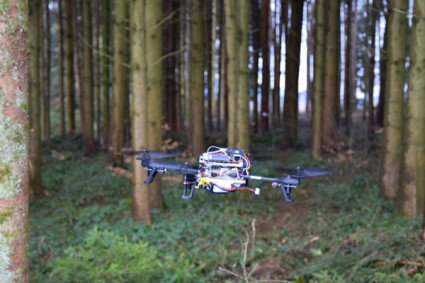 Photo of quadrotor navigating in the forest