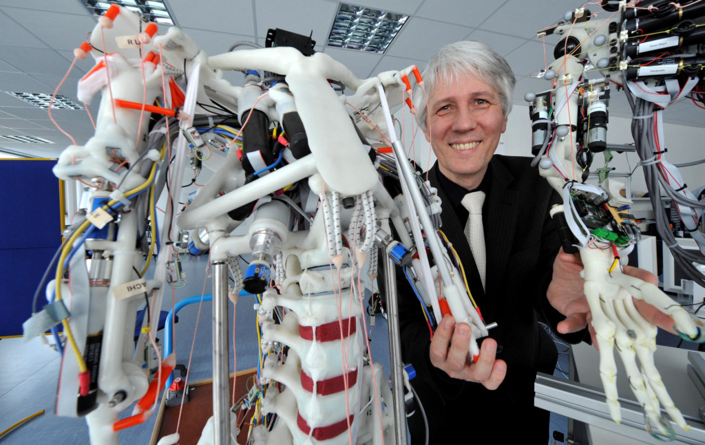 Professor Alois Knoll, chair of real-time systems and robotics, stands between two tendon driven robots developed as part of the EU project Eccerobot at the Technical University in Munich-Garching-Hochbrueck, Germany, 28 January 2013. Knoll coordinates the neuro-robotics division of the EU flagship project Human Brain Project (HBP). Photo: FRANK LEONHARDT