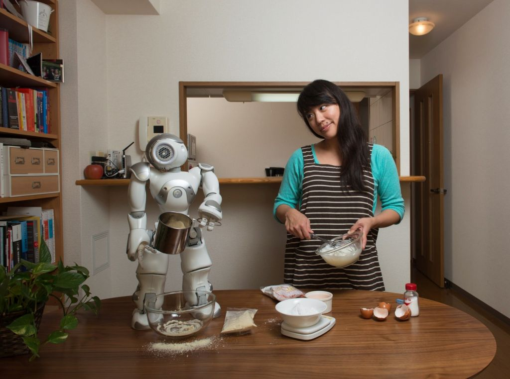 Lim with robot. Image credit: Irwin Wong