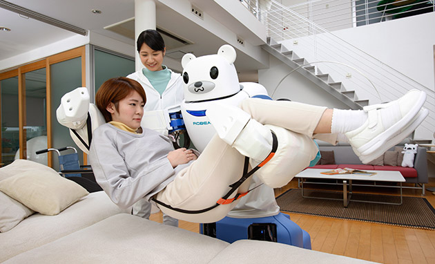 A Robear robot developed by state-backed research institute Riken can lift a person into and out of bed, potentially offering great help to increasingly aging care workers. | RIKEN