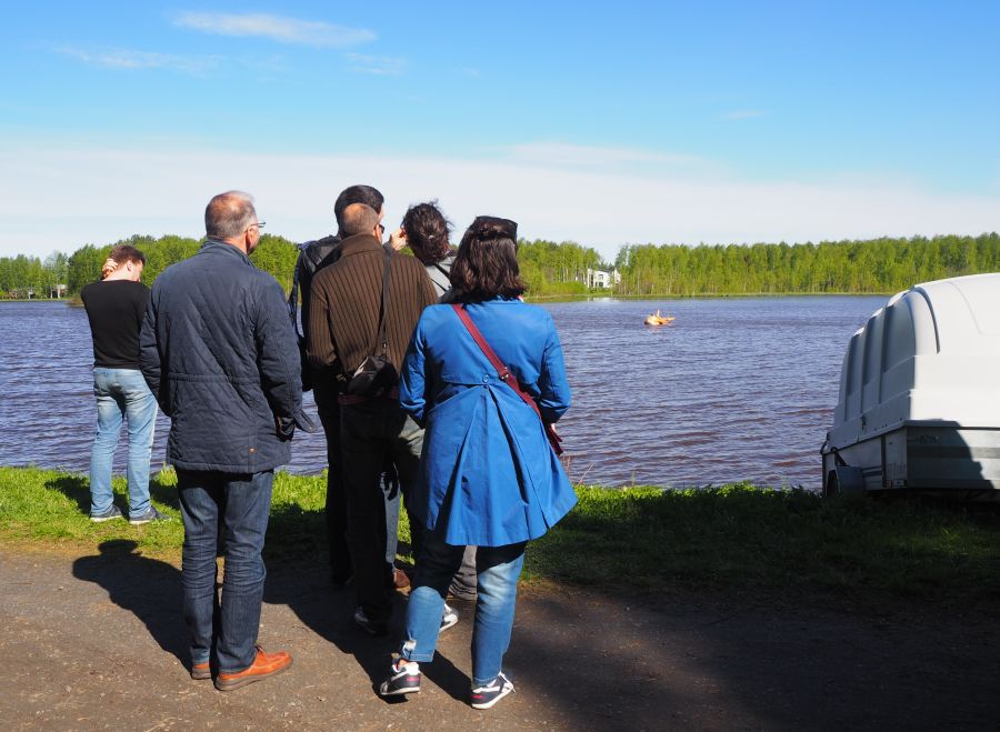 Participants of euRathlon/SHERPA 2015 summer school test the USV on the lake in Oulu.  Photo credits: euRathlon
