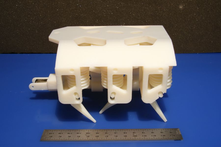 "This 3-D hexapod robot moves via a single motor, which spins a crankshaft that pumps fluid to the robot's legs. Besides the motor and battery, every component is printed in a single step with no assembly required. Among the robot's key parts are several sets of ""bellows"" 3-D printed directly into its body. To propel the robot, the bellows uses fluid pressure that is translated into a mechanical force. (As an alternative to the bellows, the team also demonstrated they could 3-D print a gear pump that can produce continuous fluid flow.) Photo: Robert MacCurdy/MIT CSAIL"