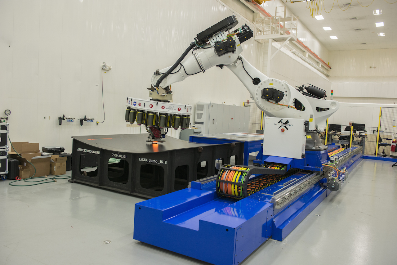 Robot weaving carbon fiber into rocket parts. Source: NASA/YouTube