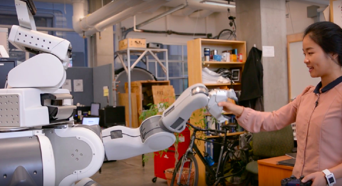 Researcher with robot. Photo source: ubcpublicaffairs/YouTube