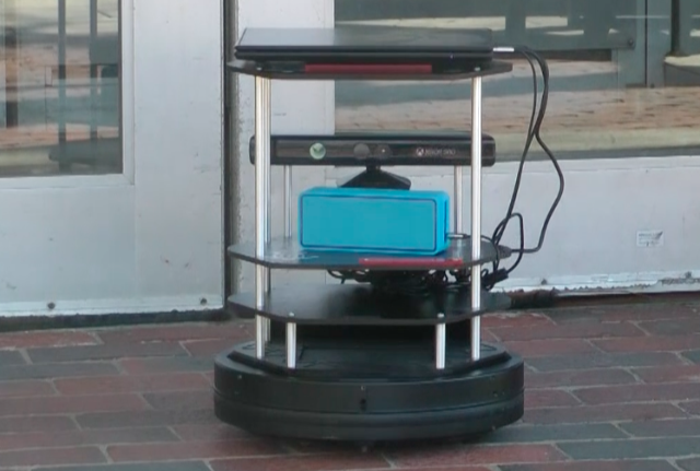 Booth's robot, Gaia, waits outside the entrance to Quincy House. (Image courtesy of Serena Booth.)