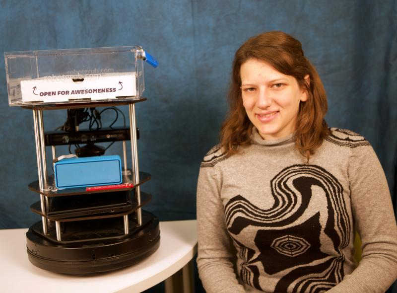 Serena Booth and her robot, Gaia, in its cookie-delivery disguise. (Photo by Adam Zewe/SEAS Communications.)