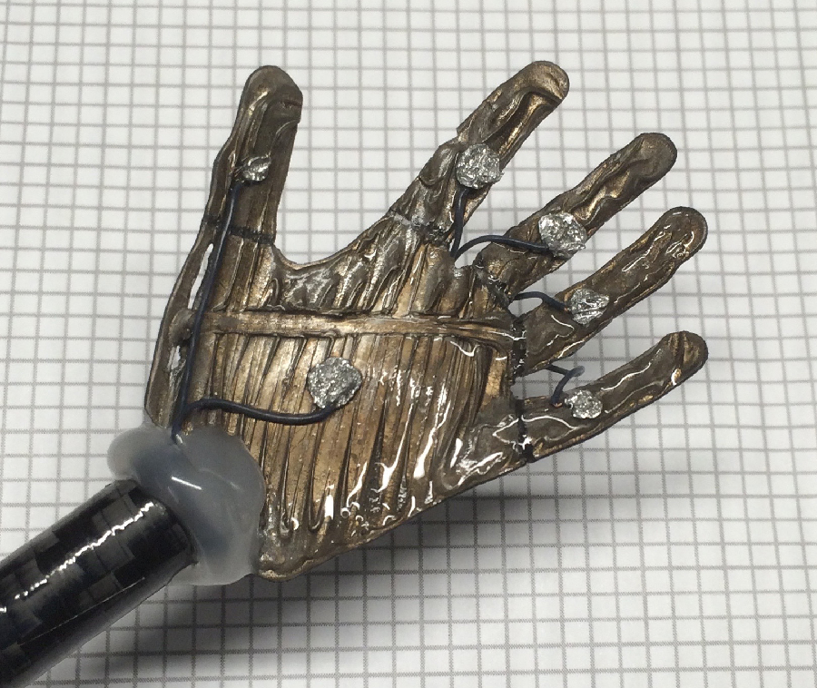 A small 3-D printed ionic polymer-metal composite soft robotic hand. National Science Foundation researchers are working to transform this material into artificial muscles. Credit: Kam K. Leang. University of Utah