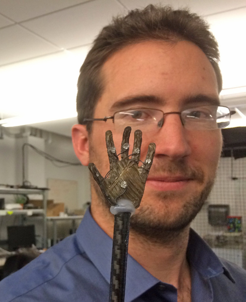 James Carrico, a Ph.D. graduate student at the University of Utah, displaying a small 3-D printed ionic polymer-metal composite soft robotic hand. Credit: Kam K. Leang
