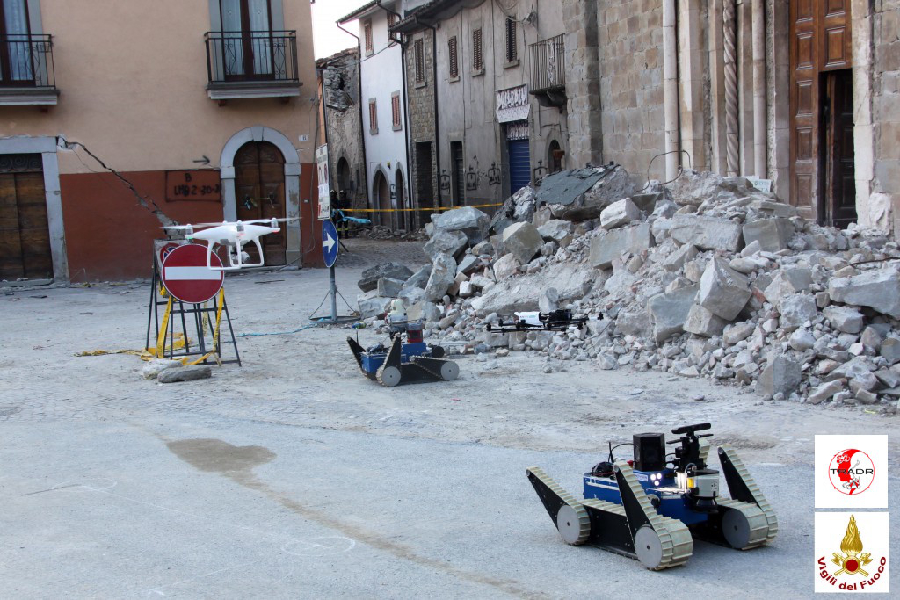 Two UGVs and two UAVs in front of the San Francesco church. Credit: TRADR project