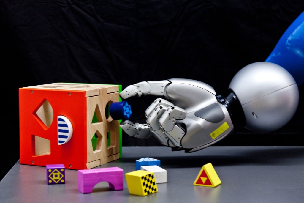 Robotic hand tries to put object in the holes of a toy. Credits: Technische Universitaet Darmstadt