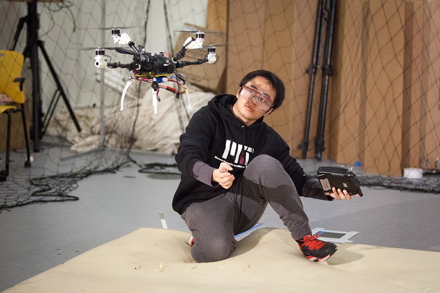 PhD student Tao Du watching the bunnycopter take off . Image credit: Jason Dorfman, MIT CSAIL
