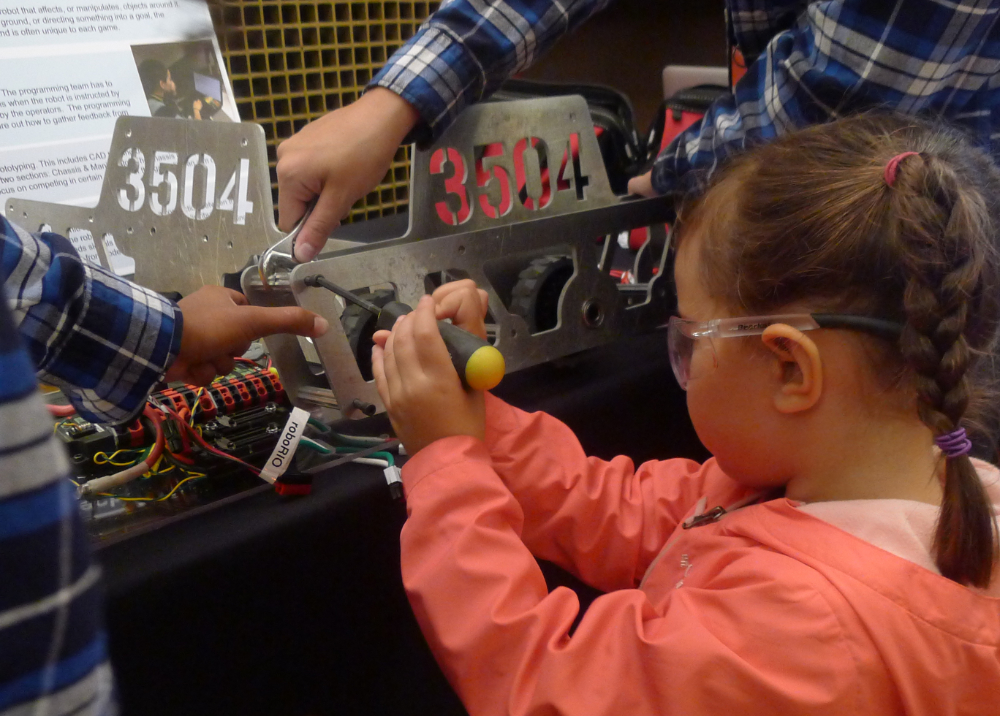 Young participant assembling the chassis at the White House Frontiers Conference in Pittsburgh, PA