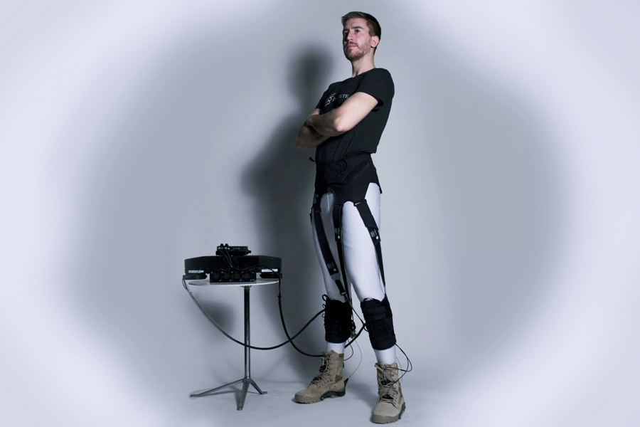 The Harvard team's exosuit is a wearable robot that directly targets the ankle joints and is made of functional textiles, cable-based actuation and a biologically-inspired control system. In this version, actuation, electronics and battery units (shown on the left) have been off-boarded to better allow the researchers to quantify the exosuit's energy-saving potential in healthy wearers. Credit: Wyss Institute at Harvard University