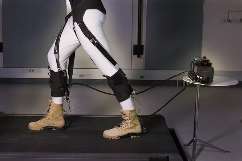 The exosuit's soft textiles strategically position the actuating cables that assist with the ankle motion at the back of the lower legs and, through additional straps, transfer energy produced at the ankle to the front of the hip to also assist with the gait's hip motion. Credit: Wyss Institute at Harvard University